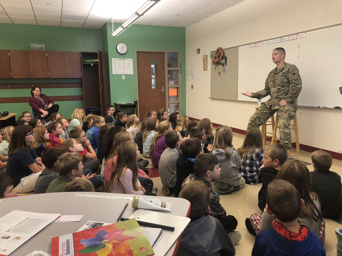 Staff Sergeant Sworobowicz meets with 3rd graders